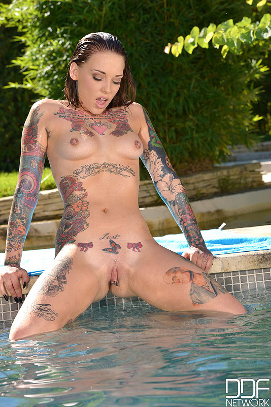 tattooed girls nude outdoors