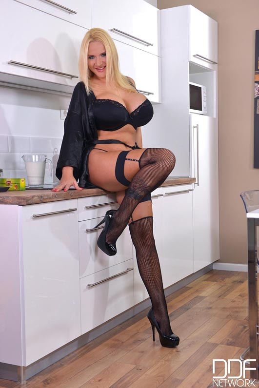 Blonde milf playing with milk in stockings